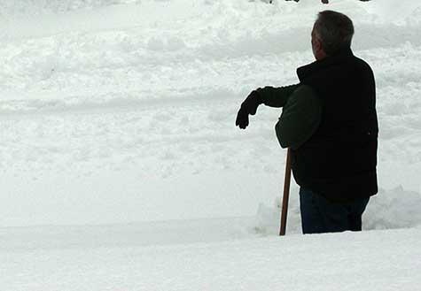 rest break from snow shoveling