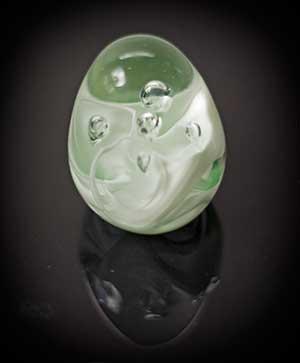 light green glass paperweight