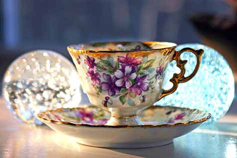teacup and paperweights