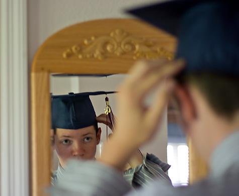 adjusting graduation cap