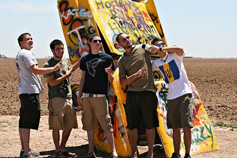pointing at the cadillacs
