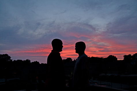 boys talking at sunset