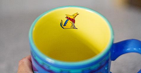 coyote inside mug