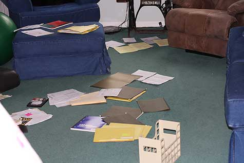 papers spread out in family room