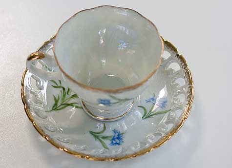 cut out saucer on teacup