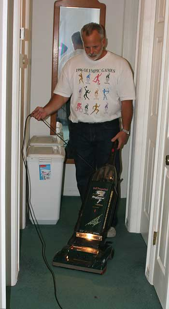 man with a vacuum