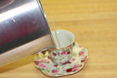 pour wax into teacup