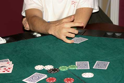 poker hand sign and chips