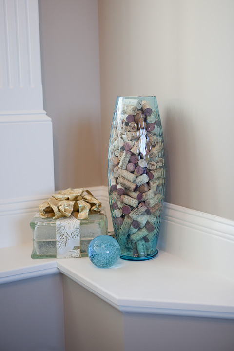 vase of wine corks and lighted box