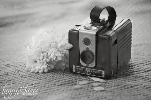 antique camera and flower black and white