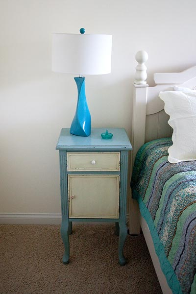 bed tables with teal lamp