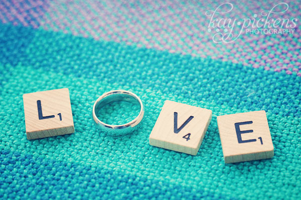 Love out of scrabble tiles and wedding ring