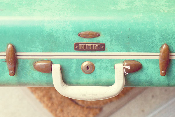 initials on old suitcase