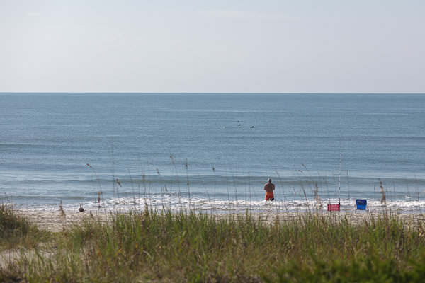 Man fishing at Holden Beach