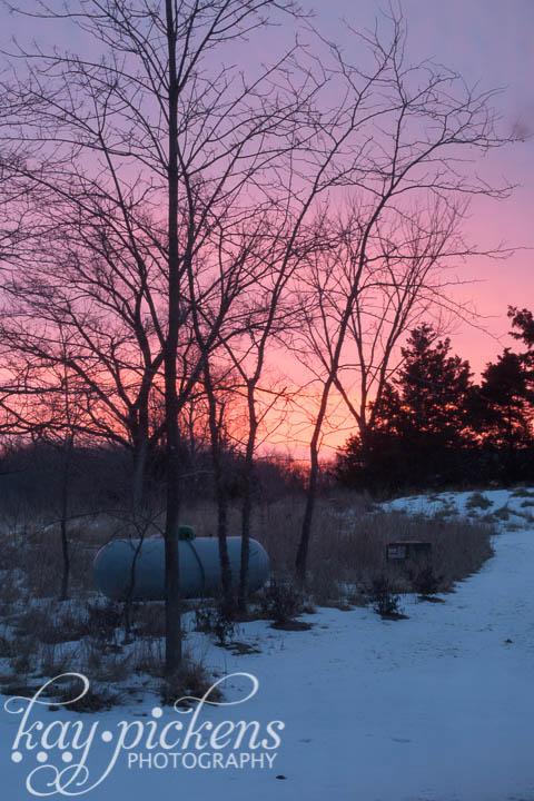 sunrise over propane tank