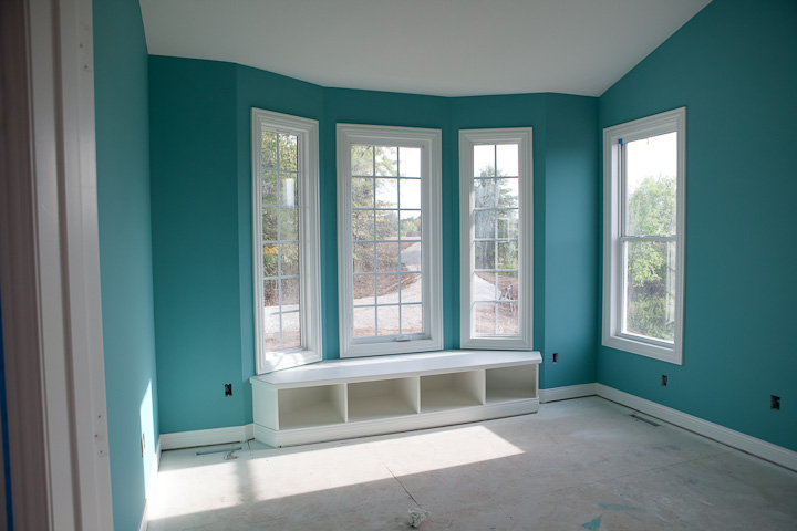 teal office in new house with window seat