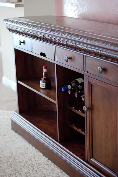 wooden bar with wine rack